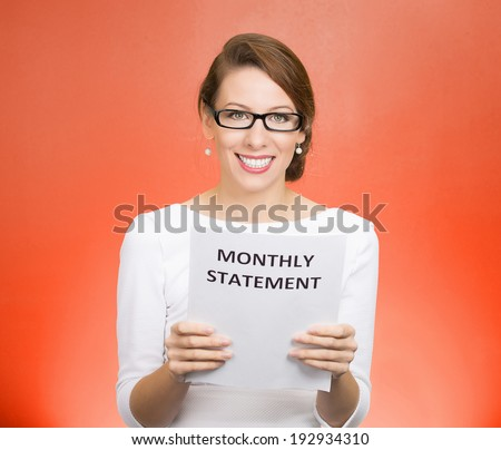Closeup portrait happy excited young business woman looking at monthly statement glad to pay off bills, isolated red background. Positive emotions, facial expressions. Financial success, good news