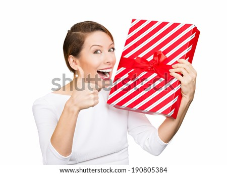 Closeup portrait happy, excited young woman about to open, unwrap red birthday gift box, giving thumbs up isolated white background. Positive emotions, facial expressions, feelings, attitude, reaction - stock photo