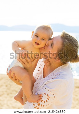 Closeup portrait happy grandmother smiling baby grandson, head to head isolated on ocean, lake, sea background. Positive human emotions, facial expressions, feelings. Family, happiness concept - stock photo