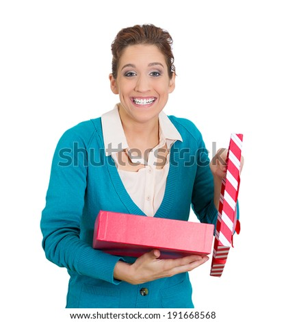 Closeup portrait happy, looking super excited young woman lady unwrapping birthday gift box, isolated white background. Positive human emotion, facial expression, feeling, attitude reaction perception