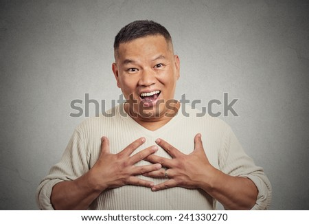 Closeup portrait happy middle aged handsome man looking shocked surprised in disbelief hands on chest open mouth eyes isolated grey wall background. Positive human emotion facial expression feeling - stock photo