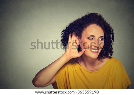 Closeup portrait happy middle aged nosy woman hand to ear gesture carefully secretly listening juicy gossip conversation privacy violation isolated on grey background. Human face expression  - stock photo