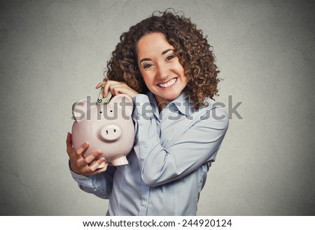 Closeup portrait happy smiling business woman bank employee, student holding piggy bank, excited to open savings account isolated grey background. Financial concept. Positive emotion facial expression - stock photo