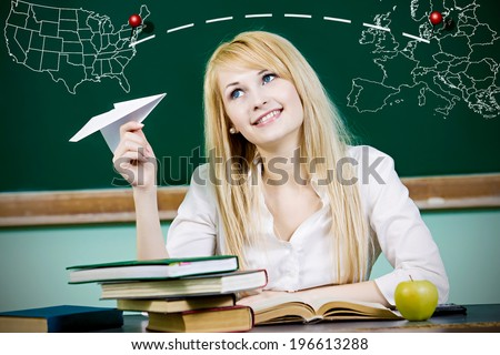 Closeup portrait happy, smiling business woman, student, teacher, girl holding paper plane, imagining, wishing flying jet isolated green chalkboard background with world travel map. Positive emotions  - stock photo