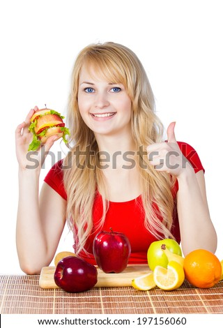 Closeup portrait happy smiling fit female holding, eating vitamin fruit sandwich burger made of apples oranges strawberries fruits giving thumbs up gesture isolated white background. Healthy lifestyle