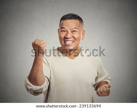 Closeup portrait happy successful business man, employee winning, fists pumped celebrating success isolated grey wall background. Positive human emotion, facial expression. Life perception achievement - stock photo