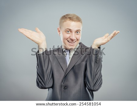 Closeup portrait happy successful business man winning, fists pumped celebrating success isolated grey wall background. Positive human emotion, facial expression. Life perception, achievement - stock photo