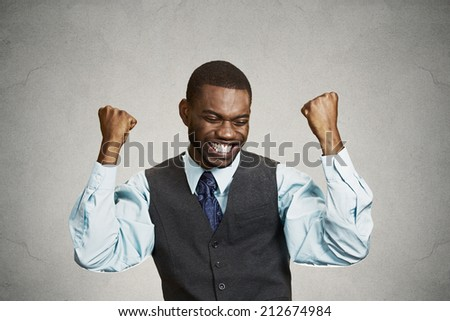 Closeup portrait happy successful student, business man winning, fists pumped celebrating success isolated grey wall background. Positive human emotion, facial expression. Life perception, achievement - stock photo