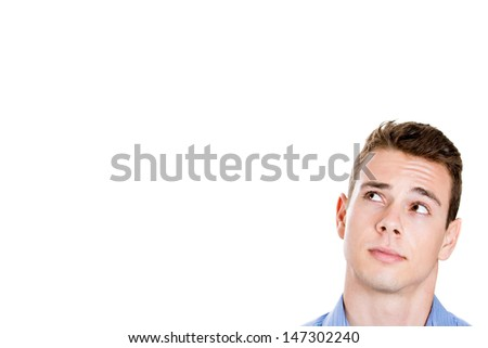 Closeup portrait head shot of handsome man daydreaming, looking up and to side with lots of copy space, isolated on white background  - stock photo