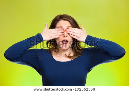 Closeup portrait, head shot young, coy woman, female closing eyes with hands can't see, hiding, mouth open, isolated green background. See no evil concept. Negative emotion, facial expression feeling - stock photo