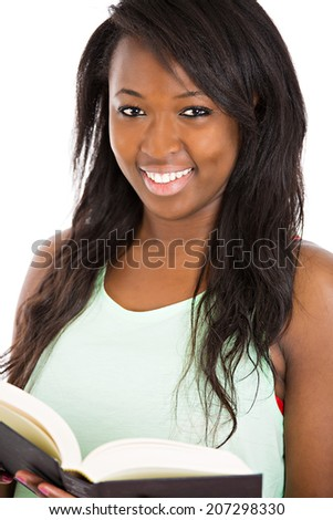 Closeup portrait, headshot attractive young happy smiling woman, satisfied student holding opened text books, isolated white background. Education college concept. Positive emotions, face expression - stock photo
