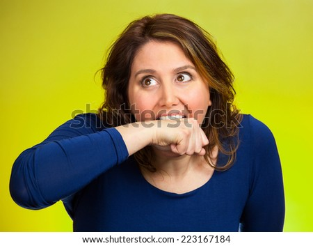 Closeup portrait headshot crazy angry loony middle aged business woman worker employee going nuts through stress conflict in life biting her arm isolated green background. Negative human emotion - stock photo