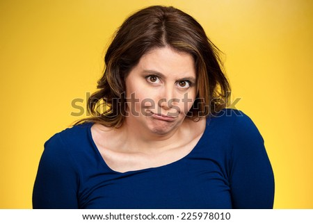 Closeup portrait headshot displeased, pissed off, angry, grumpy middle aged woman with bad attitude looking at you isolated yellow background. Negative human emotions, facial expressions, feelings - stock photo