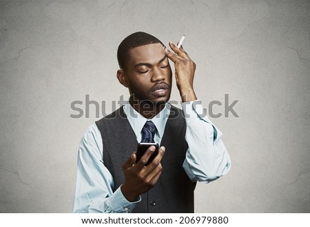 Closeup portrait, headshot mad pissed off business man, corporate executive holding smart phone irritated upset about situation isolated black background. Negative emotion, facial expression reaction - stock photo