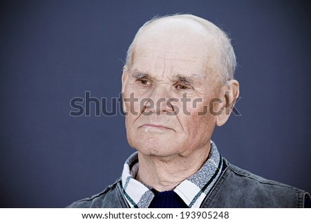 Closeup portrait, headshot senior, mature, elderly man, old sad guy, troubled, deep thought isolated black background. Human emotions, facial expressions, life perception aging, depression, loneliness - stock photo