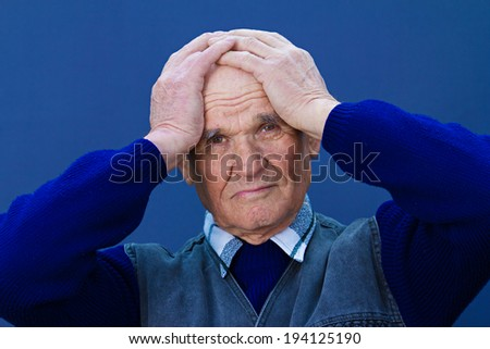 Closeup portrait, headshot senior, worried mature elderly man, old sad guy, grandfather, troubled, isolated blue background. Human emotions, facial expressions, life perception, aging, depression - stock photo