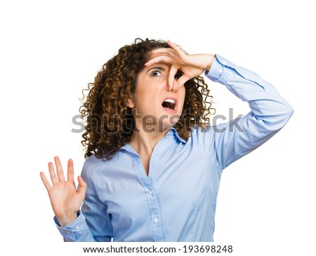 Closeup, portrait, headshot unhappy woman covers her nose, looks displeased, something stinks, bad smell, situation, isolated white background. Human facial expressions, emotions, feelings, reaction - stock photo