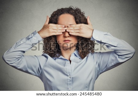 Closeup portrait headshot young woman closing covering eyes with hands can't look hiding avoiding situation isolated grey wall background. See no evil concept. Human emotion face expression perception - stock photo