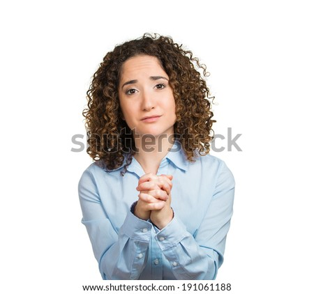 Closeup portrait, headshot young woman, worker with hands clasped to chest, very thankful looking at you, camera isolated white background. Positive human emotion, facial expression, reaction attitude - stock photo