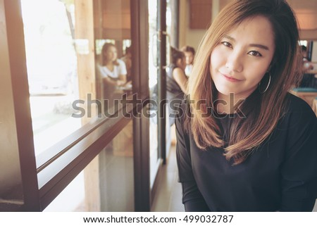 Closeup portrait image of beautiful asian woman with smiley face and feeling good , beauty fashion and lifestyle