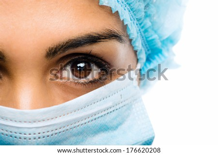 Closeup portrait Indian woman Doctor surgeons serious white background - stock photo