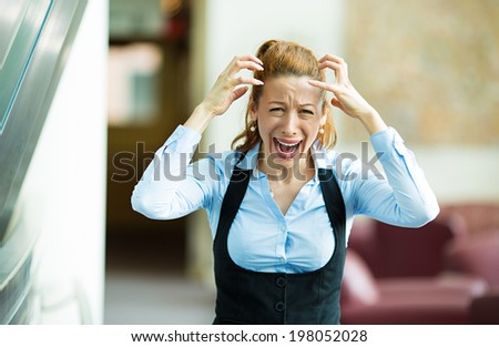 Closeup portrait mad, angry, upset stressed young businesswoman, worker, furious yelling hands in air, isolated background corporate office. Negative human emotions, facial expression, reaction - stock photo