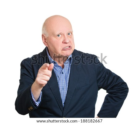 Closeup portrait, mad, serious senior mature man, pointing at you with index finger hand sign gesture, isolated white background. Negative human emotion facial expression feelings, symbols