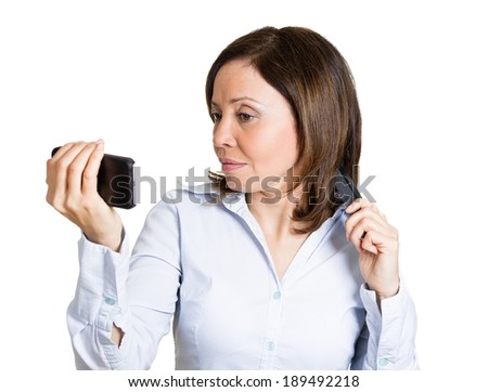 Closeup portrait, mature, cocky, beautiful, woman looking admiring her face and hair in front of pocket mirror, mobile phone, isolated white background. Negative emotion facial expression feeling