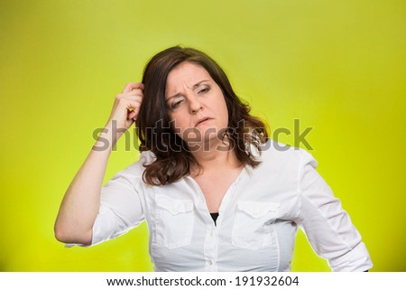 Closeup portrait middle age woman scratching head, thinking daydreaming deeply about something, looking sideways, isolated green background. Human facial expression, emotion, feelings, signs symbols - stock photo