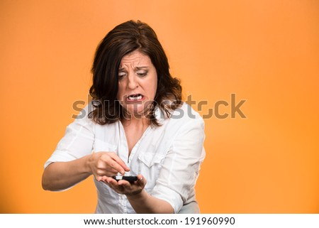 Closeup portrait middle aged, mad, frustrated angry woman yelling on phone isolated orange background. Negative human emotion, facial expression, feeling, reaction Communication, conflict resolution - stock photo