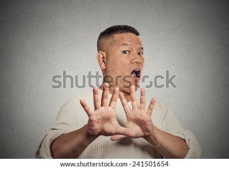 Closeup portrait middle aged  man looking shocked scared trying to protect himself from unpleasant situation dodge isolated grey wall background. Negative emotion face expression feeling reaction - stock photo