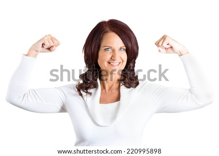 Closeup portrait middle aged woman flexing muscles showing, displaying her strength, isolated white background. Positive human emotions, facial expressions, feelings, attitude, life perception - stock photo