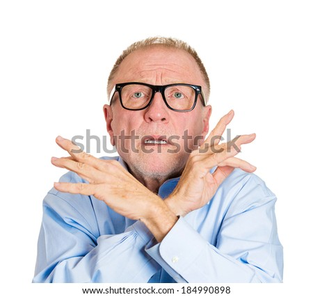 Closeup portrait, nerd senior mature man in black glasses, looking scared, shocked, hands in air with x sign looking up, isolated white background. Negative human emotion facial expression, reaction - stock photo
