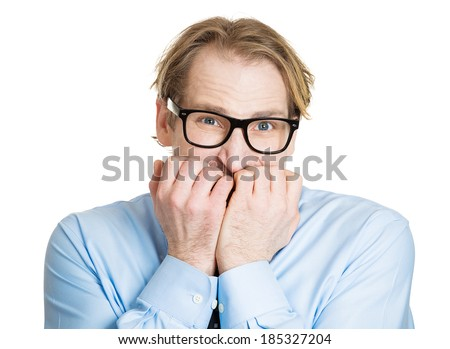 Closeup portrait, nerdy young guy with black glasses biting his nails, looking funny, scared, craving something, anxious, isolated white background. Human facial expressions, emotions, feelings - stock photo