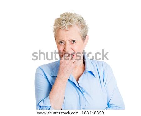 Closeup portrait nervous, senior mature woman, biting fingernails craving something, anxious, isolated white background. Negative human emotion, facial expression, feeling reaction - stock photo