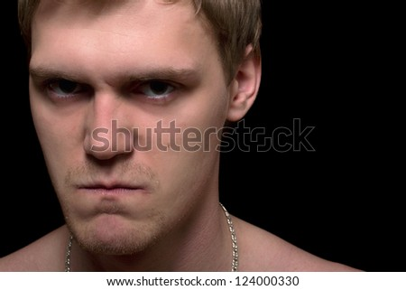 Closeup portrait of a angry young man. Isolated - stock photo