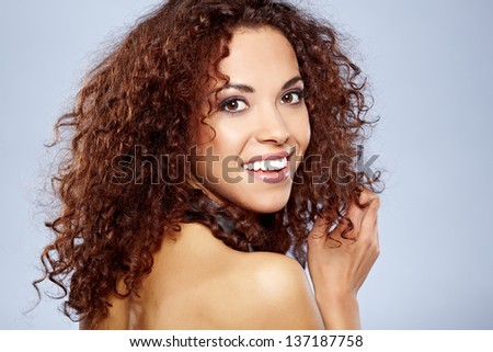 Closeup portrait of a attractive young African American woman smiling - stock photo