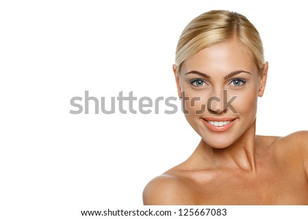 Closeup portrait of a beautiful blond female model on white background