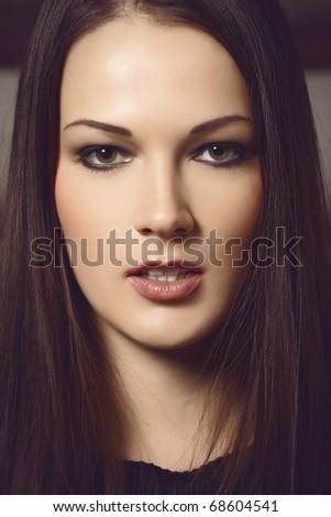 Closeup portrait of a beautiful brunette lady. Cross process toning. - stock photo
