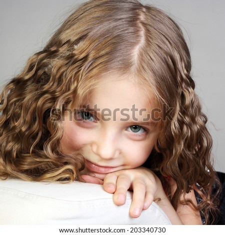 closeup portrait of a beautiful curly little girl
