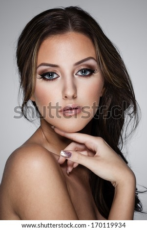Closeup portrait of a beautiful lady on grey - stock photo