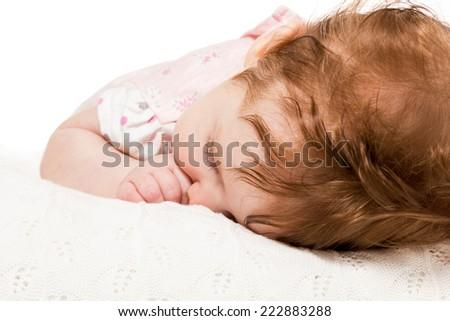 Closeup portrait of a beautiful sleeping baby on white - stock photo