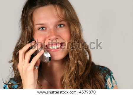 closeup portrait of a beautiful teenager girl with cell phone