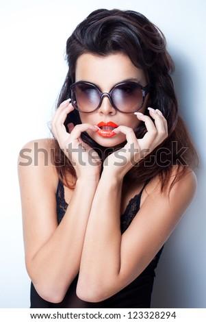 Closeup portrait of a beautiful woman wearing trendy sunglasses - stock photo