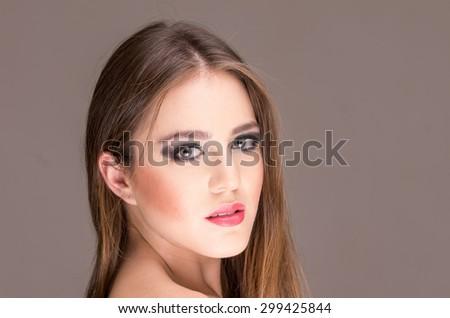 closeup portrait of a beautiful young girl posing wearing sensual makeup - stock photo