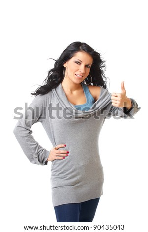 Closeup portrait of a beautiful young girl showing thumb up sign - stock photo