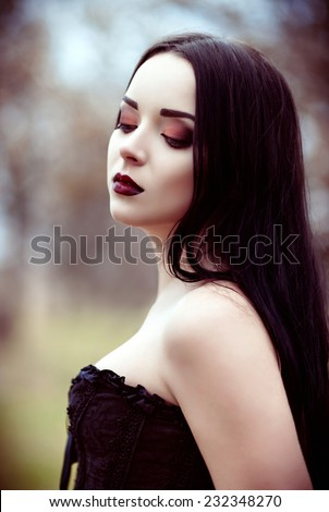 Closeup portrait of a beautiful young goth girl  - stock photo
