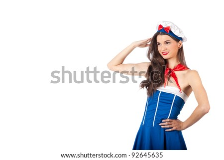 Closeup portrait of a beautiful young sailor woman with big brown eyes, saluting. High resolution image taken in studio. Isolated on pure white background with copy space for your ad.