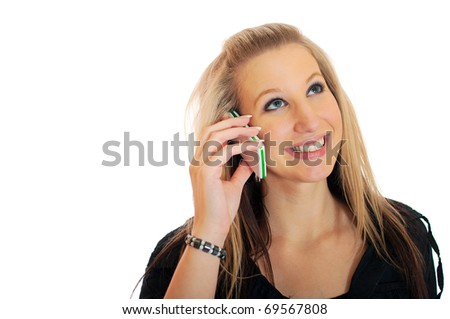 Closeup portrait of a beautiful young smiling woman talking on mobile phone against white background - stock photo