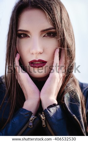 Closeup portrait of a beautiful young woman - stock photo